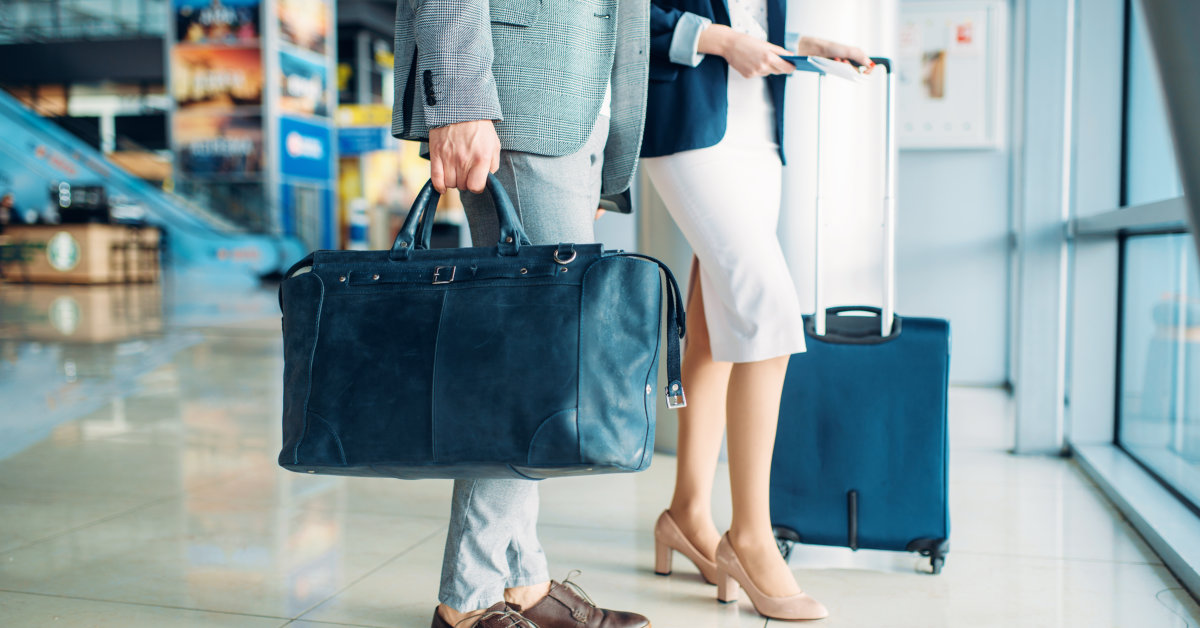 Man and woman standing in airport for business trip