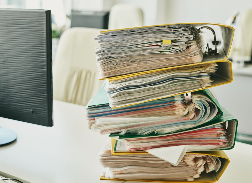 Pile of binders with tax returns